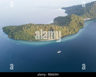 A small liveaboard dive boat in the Banda Islands of eastern Indonesia. - Stock Photo
