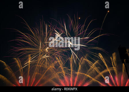 Fireworks display in the night sky - Stock Photo