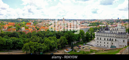 Aerial panorama of Vilnius old town, Lithuania. Beautiful and bright summer panoramic view from top of the hill of Gediminas Tower - Stock Photo