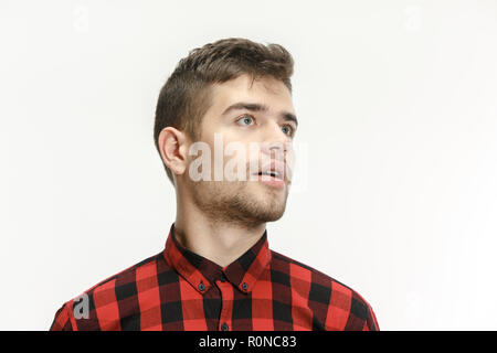 Wow. Attractive male half-length front portrait on studio backgroud. Young emotional surprised bearded man standing with open mouth. Human emotions, facial expression concept - Stock Photo