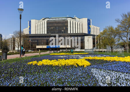 SOFIA, BULGARIA -APRIL 14, 2018:  Flower garden and National Palace of Culture in Sofia, Bulgaria - Stock Photo