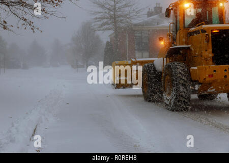 Snow removing machine cleans the street from the snow - Stock Photo