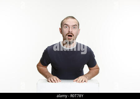 Wow. Attractive male half-length front portrait on studio backgroud. Young emotional surprised bearded man with open mouth. Human emotions, facial expression concept - Stock Photo