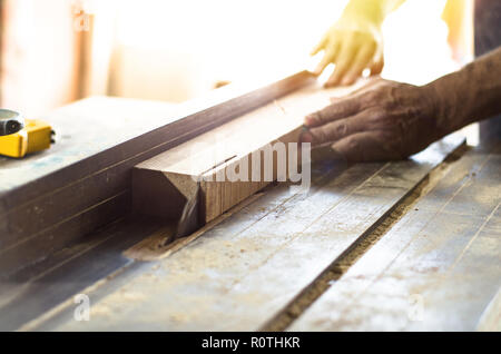 Carpenter tools on wooden table with sawdust. Cutting a wooden plank - Stock Photo