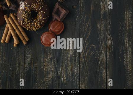 Chocolate donuts on wood - Stock Photo