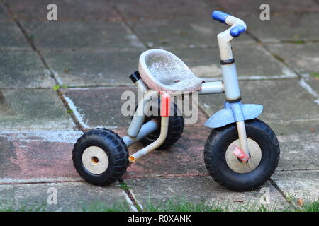 Retro child tricycle bike on the pavement - Stock Photo