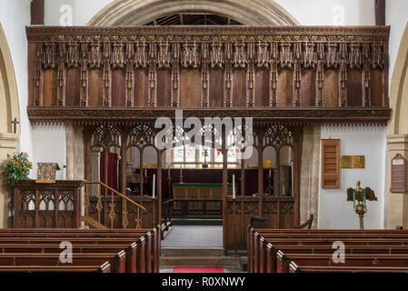 An intricately carved 16th century Rood Screen preserved in St. Oswald's Church, Flamborough, Yorkshire, UK - Stock Photo