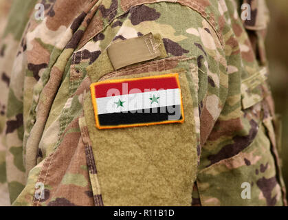 Syrian flag on soldiers arm. Syria army. Syrian troops. - Stock Photo