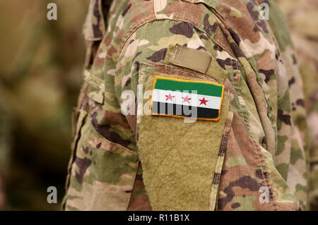 Soldiers arm with Flag used by the Syrian Opposition and Syrian Revolutionary and Opposition Forces - Stock Photo