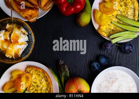 Ingredients of healthy dietary food breakfast pink grapefruit, orange, chia seeds, quinoa, green herbs, kiwi, wild rice, almond, walnuts, hazelnuts on - Stock Photo