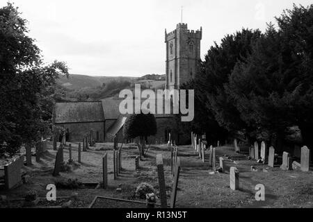 St. Peter's Church, Berrynarbor, Near Ilfracombe, Devon, showing graveyard in foreground in black and white, in winter, in the parish of Exeter. - Stock Photo