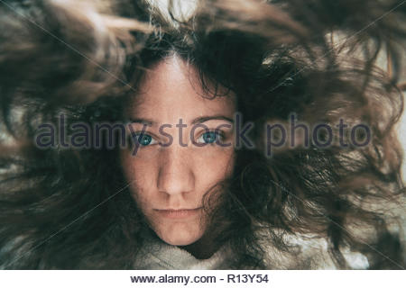 A woman looking into the camera under water - Stock Photo