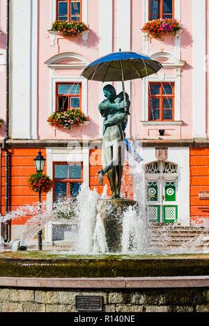 Fountain of kissing students, in the background the town hall. Tartu, Tartu County, Estonia, Baltic states, Europe. - Stock Photo