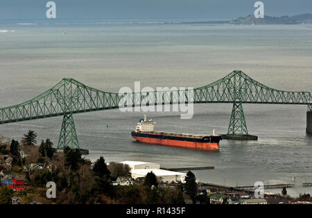 OR02360-00...OREGON - Cargo ship passing under the Astoria Bridge on the Columbia viewed from the Astoria Column at the mouth of the Columbia River. - Stock Photo