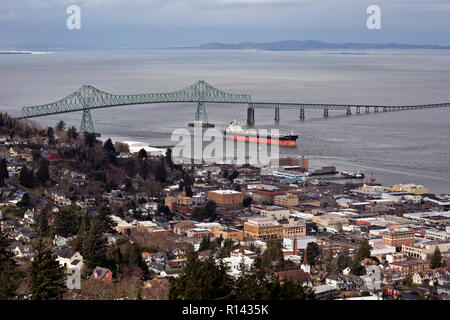 OR02361-00...OREGON - Cargo ship passing under the Astoria Bridge at the town of Astoria on the Columbia River viewed from the Astoria Column. - Stock Photo
