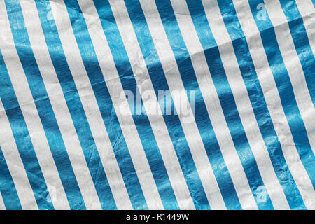 Creased plastic polyethylene film with striped pattern, background photo texture - Stock Photo