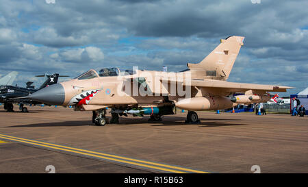 A Royal Air Force Tornado GR4 bomber in desert camouflage and with sharks teeth artwork for the static line up at RIAT, RAF Fairford, UK on 14/7/17. - Stock Photo