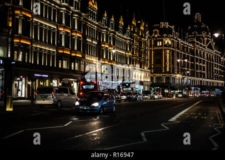View of the Harrods Department Store on Brompton Road in Knightsbridge, London at night. - Stock Photo