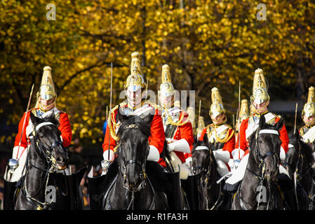 Life Guards of the Household Cavalry Mounted Regiment on horseback at the Lord Mayor's Show Parade, London, UK. Autumn leaves on tree. Fall colors - Stock Photo