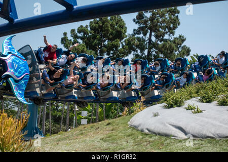 Riders on the Manta roller coaster ride take a bend in in SeaWorld San Diego, California, United States. - Stock Photo