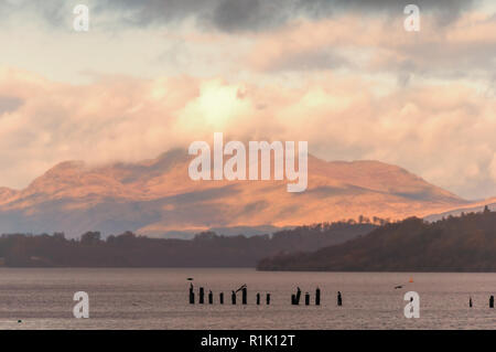 Balloch, Scotland, UK. 13th November, 2018. UK Weather. Loch Lomond with Ben Lomond in the background, viewed from Loch Lomond Shores during sunshine and showers on a cold afternoon. Credit: Skully/Alamy Live News - Stock Photo