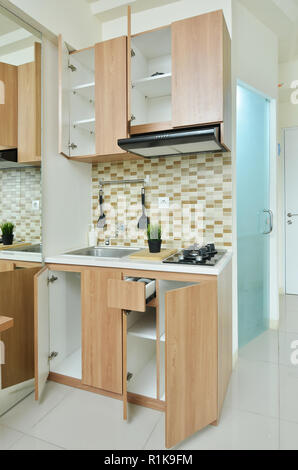 Kitchen set in small apartement - Stock Photo