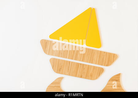 close-up view of beautiful handmade boat from wooden and yellow elements isolated on white - Stock Photo