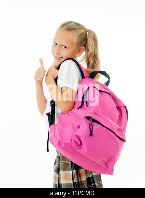 Pretty cute blonde hair girl with a pink schoolbag looking at camera showing thumb up gesture happy to go to school isolated on white background in ba - Stock Photo