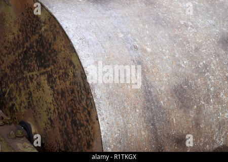 small part side view of a metal farm roller, old and rusty metal farm roller made of heavy iron - Stock Photo