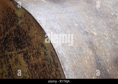 marco shot of a small part side view of a metal farm roller, old and rusty metal farm roller made of heavy iron - Stock Photo