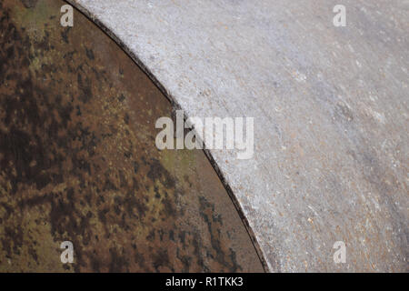 part of a metal farm roller, old and rusty metal farm roller made of heavy iron - Stock Photo