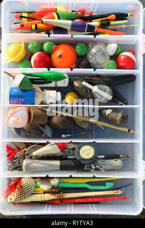 fishing tackle box for recreation and sports at the waterside - Stock Photo