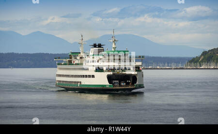 SEATTLE, WASHINGTON STATE, USA - JUNE 2018: Large passenger and car ferry arriving in Seattle after crossing Puget Sound. - Stock Photo