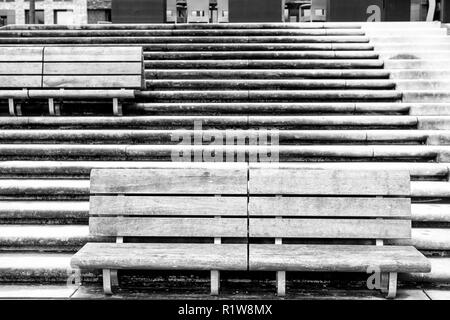 Benches on stone stairs in Hamburg, Germany. Relax, rest, seat, outdoor furniture. Architecture, structure, design style Perspective shape symmetry geometry new technologgy - Stock Photo