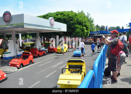 Editorial - LEGO miniland in Legoland Windsor theme park. The children has raced with the Lego Fiat cars. Lego cars and a Fiat gazoline station. - Stock Photo