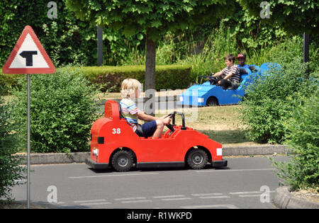 Editorial - LEGO miniland in Legoland Windsor theme park. The children are driving small lego cars by themselves. - Stock Photo