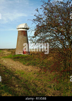 The disused drainage wind pump on the marshes  at the edge of Martham Broad at West Somerton, Norfolk. - Stock Photo