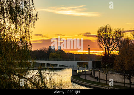 Sunset over Berlin´s government district with victory column in the background - Stock Photo