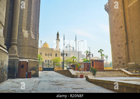 The view on the Al-Mahmoudia mosque and the  great Alabaster (Muhammad Ali) mosque of Saladin Citadel from the pass between the huge walls of Al-Rifai - Stock Photo