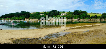 St Just in Roseland, UK - 25th July 2017: Low tide and a calm summer morning bring a few boats out onto the creek at St Just in Roseland on the picturesque Roseland Peninsula in Cornwall, UK - Stock Photo