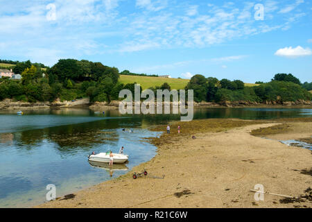 St Just in Roseland, UK - 25th July 2017: A calm summer morning brings people out to exercise their dogs by the creek at St Just in Roseland on the picturesque Roseland Peninsula in Cornwall, UK - Stock Photo