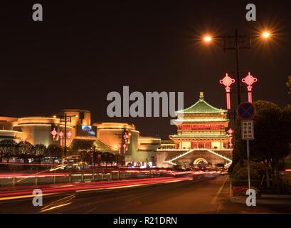 Illuminated drum tower in Xian, China at night - Stock Photo