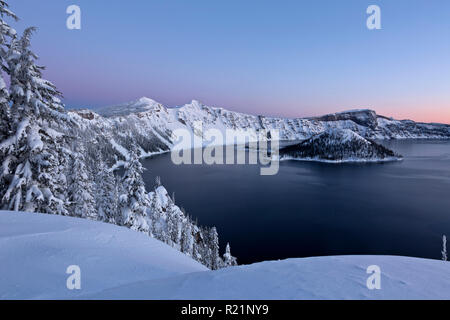 OR02414-00...OREGON - Dawn along the snow covered rim of Crater Lake in Crater Lake National Park. - Stock Photo