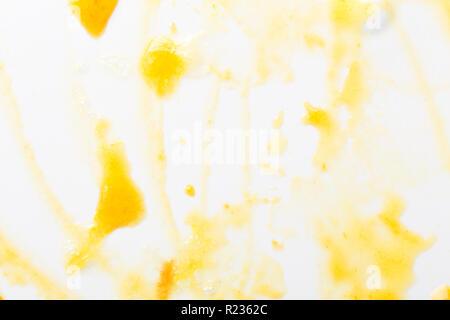 Yellow jam drops on macro. Abstract background of jam. - Stock Photo