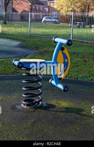 Children's play equipment in local park, Westbury, Wiltshire, UK. - Stock Photo