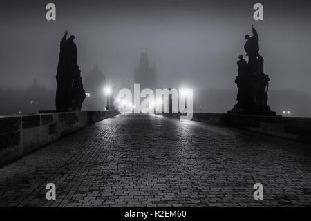 On the famous Charles Bridge in the morning mist, Prague, Czech Republic, Europe - Stock Photo