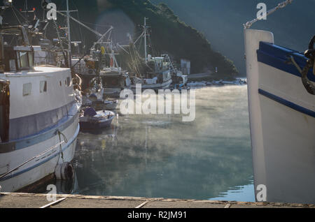 Small fishing boat docked in a Croatian fishers village - Stock Photo