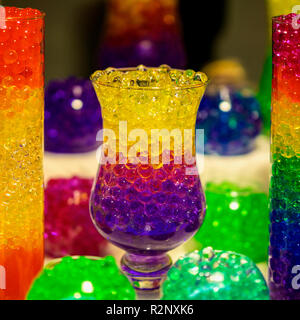 Glass vase with a absorbent balls of hydrogel, bright colored colors - Stock Photo