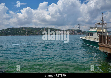 The first one bridge of Bosphorus channel at Istanbul in Turkey. This bridge connecting Europe with Asia.European continent cityscape from Asia contin - Stock Photo