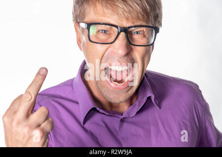 Portrait of a angry man with glasses staring at camera, shows finger and shouting over white background - Stock Photo